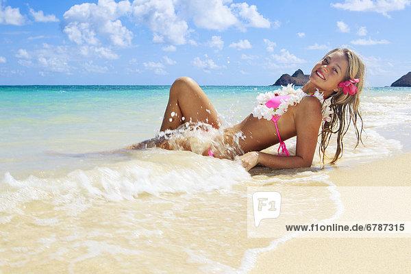 Hawaii  Oahu  Kailua  Lanikai Beach  Teenage girl on beach.
