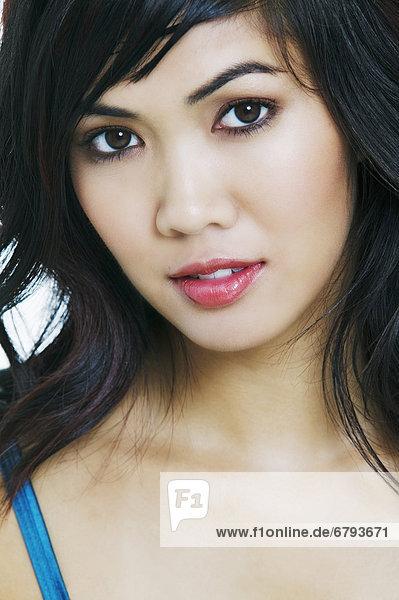 Close-up of a beautiful asian woman.