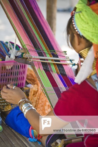 Girl Weaving Brightly Colored Threads  Chiang Mai Thailand
