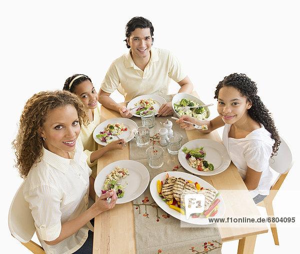 Abendessen Portrait Menschliche Eltern Tochter 10-13 Jahre 10 bis 13 Jahre essen essend isst