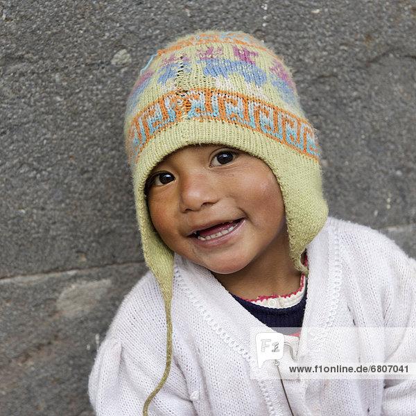 Portrait Of A Young Boy Wearing A Hat  Cusco Peru