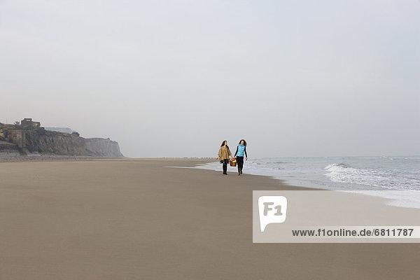 France  Pas-de-Calais  Escalles  Two women strolling on empty beach