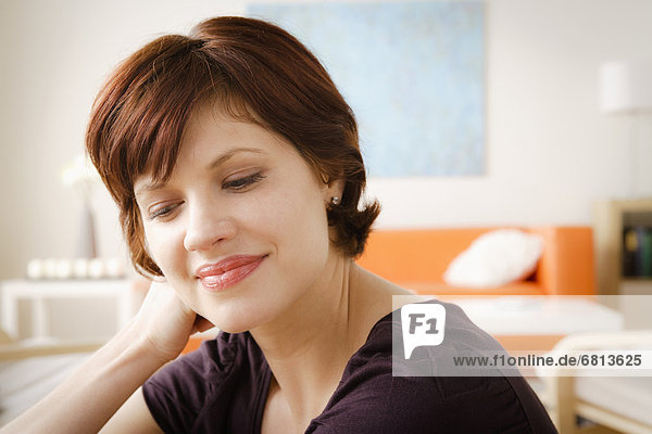 Young smiling woman looking away