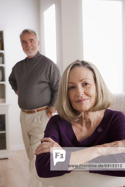 Portrait of smiling senior woman  senior man in background