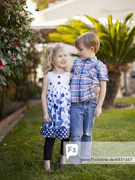 Outdoor portrait of girl (4-5) and boy (6-7)