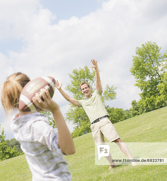 Couple playing with football