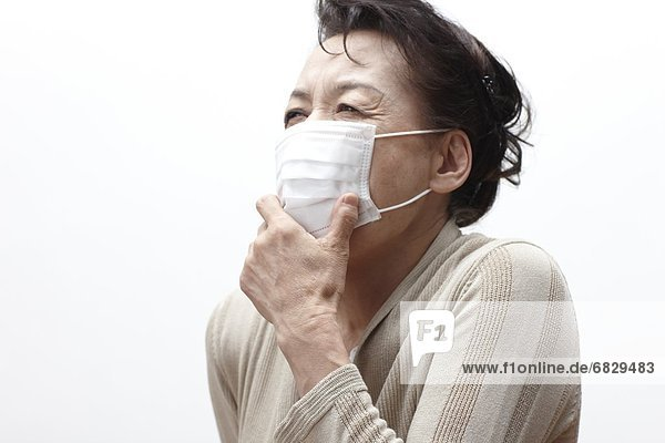 Frau  Chirurgie  Kleidung  Maske  husten