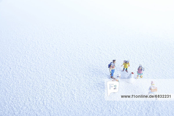 Children and snowman figurine