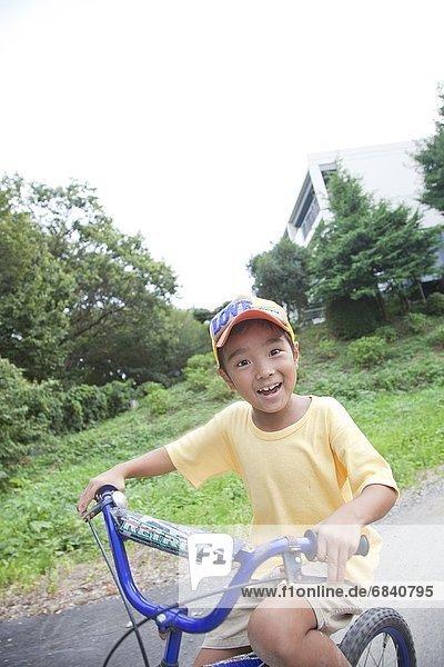 A Boy Riding Bicycle