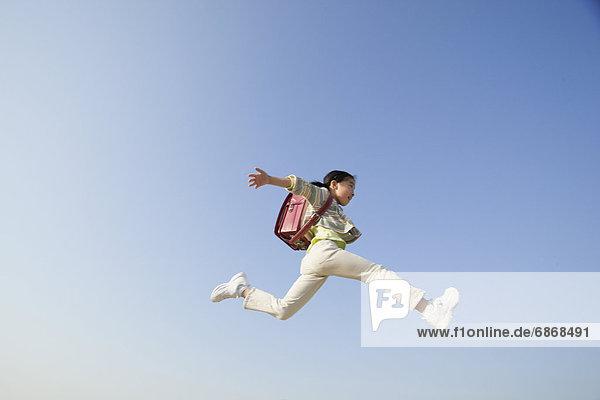 springen  Himmel  Schülerin