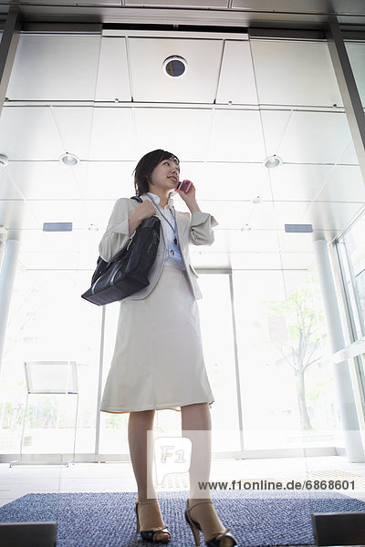Low Angle View of Businesswoman in Lobby