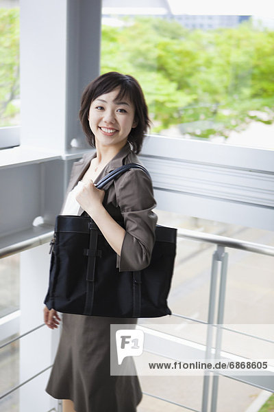 Businesswoman by Window