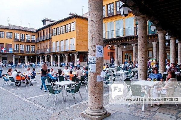 People sitting on terraces at Main Square. Tordesillas  Valladolid province  Castilla Leon  Spain.
