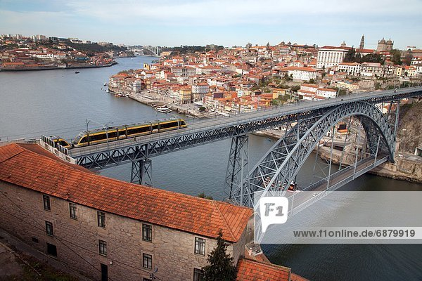 The Dom Luis 1 Bridge over the River Douro showing Porto Metro light rail in transit and Arrabida Bridge in background  Porto (Oporto)  Portugal  Europe