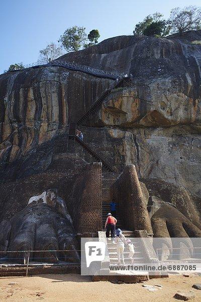 People climbing up Sigiriya  UNESCO World Heritage Site  North Central Province  Sri Lanka  Asia
