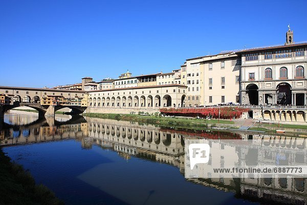 On the right The Uffizi Gallery reflected in the Arno River  Florence  UNESCO World Heritage Site  Tuscany  Italy  Europe
