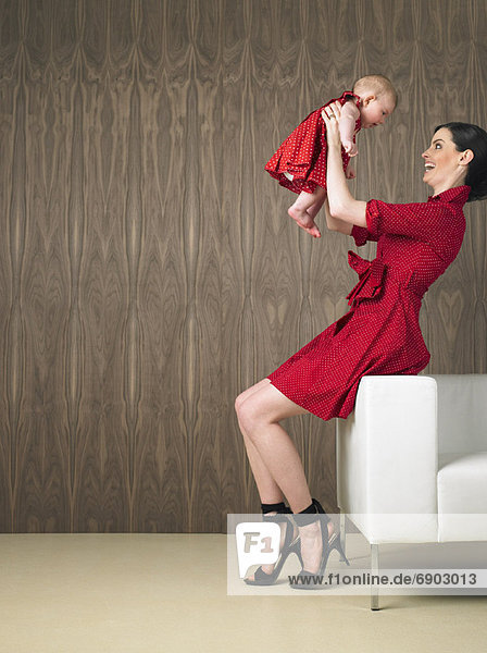Mutter Lifting Baby