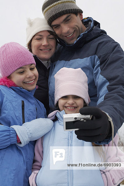 Father Taking Picture of Family