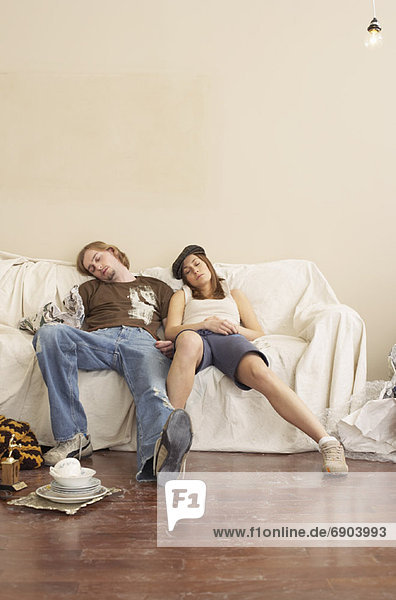 Couple on Sofa in New Home