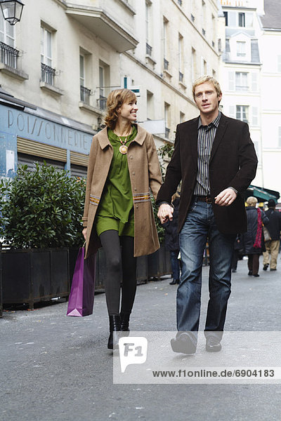 Couple Holding Hands and Walking