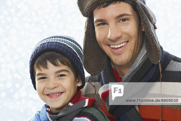 Portrait of Father and Son Wearing Winter Clothing