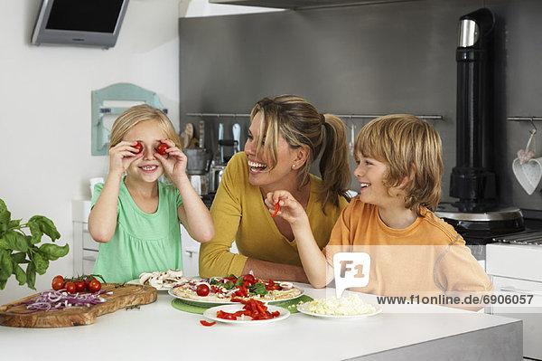 Mother and Children in Kitchen