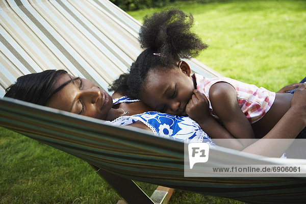 Mother and Daughter Sleeping in Hammock
