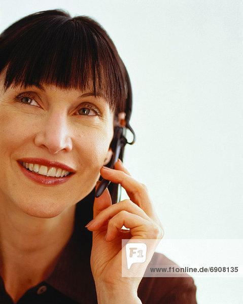 benutzen  Portrait  Geschäftsfrau  Telefon  Headset