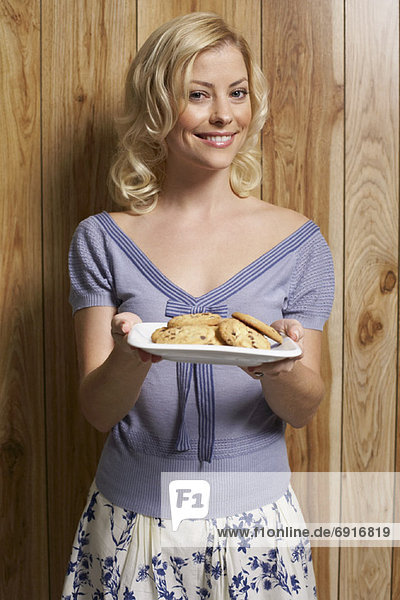 Woman Holding Plate von Cookies