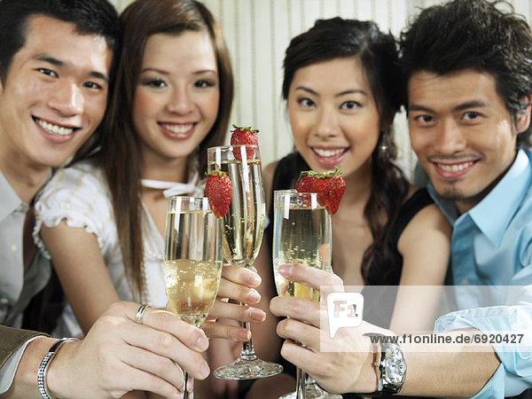 Portrait of Group with Champagne And Strawberries