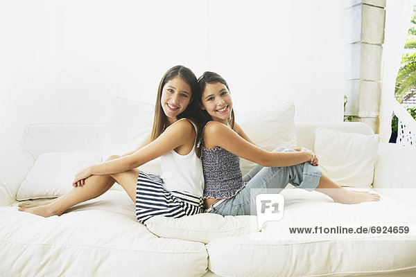 Girls Sitting on Couch