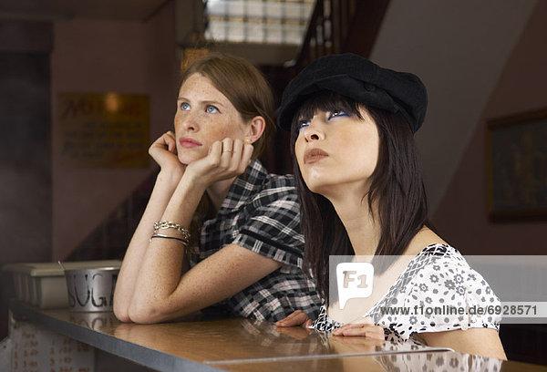 Women Standing at Bar