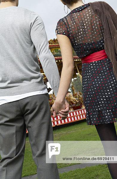 Couple Holding Hands  Carters Steam Fair  England