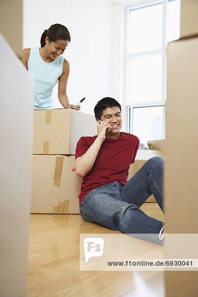 Woman Packing  Man on Cellular Phone