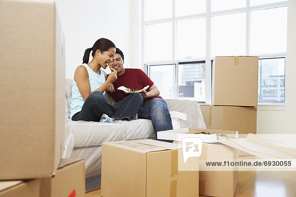 Couple Eating Pizza in New Condo