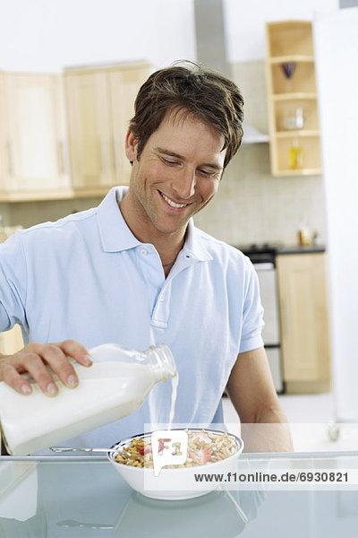 Getreide Mann essen essend isst Frühstück