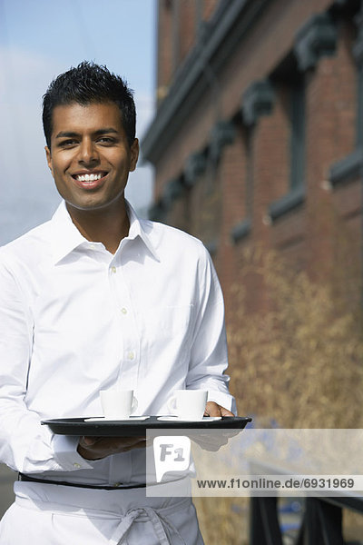 Waiter Carrying Tray Outdoors
