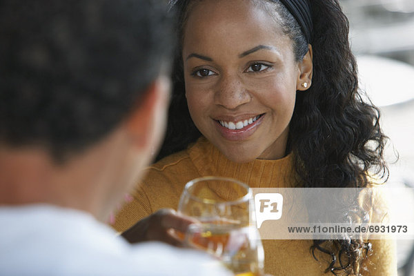 Woman Looking at Man while Drinking Wine