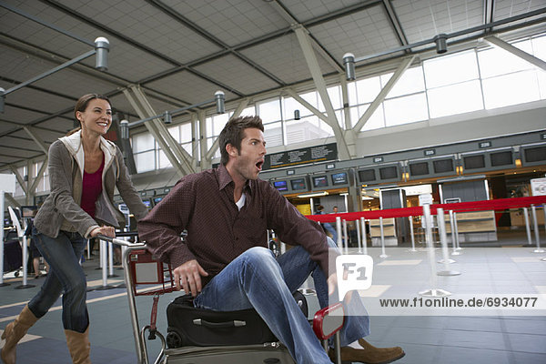 Couple Rushing Through Airport  Vancouver  British Columbia  Canada
