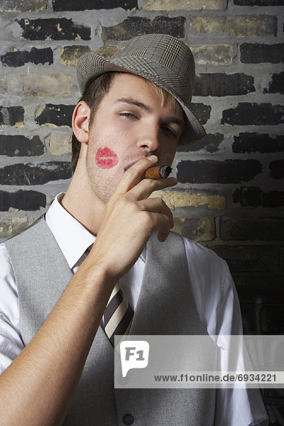 Portrait of Man With Lipstick Mark on Cheek  Smoking a Cigar