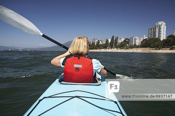 Woman Kayaking in False Creek  English Bay  Vancouver  British Columbia  Canada