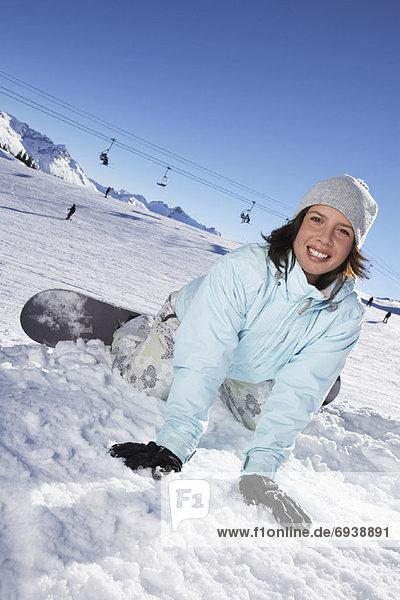 Frau  Snowboard  fallen  fallend  fällt
