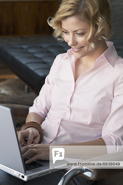 Woman Using Laptop Computer