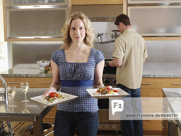 Couple Serving Dinner
