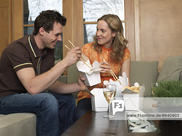 Couple Eating Chinese Food