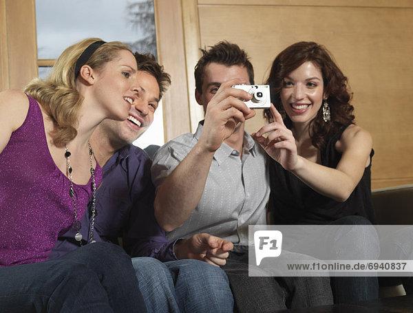 Group of People Using Digital Camera