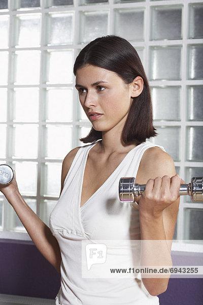Frau Aufhebung Gewichte