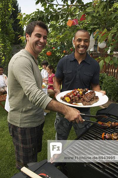 Men at Barbecue
