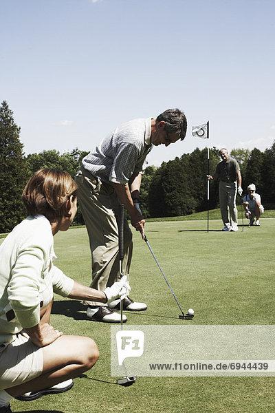 Golf spielen Paare