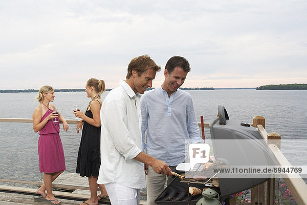 People Barbecuing  Standing by Lake